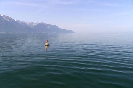 leman: Quiet Lac Leman and Swiss Alps with snow caps near Montreux in Switzerland in summer Stock Photo