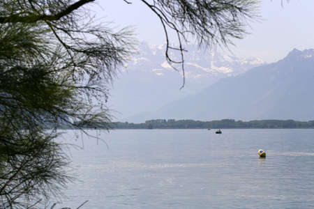 lac: Lac Leman and Swiss Alps with snow caps near Montreux in Switzerland in summer