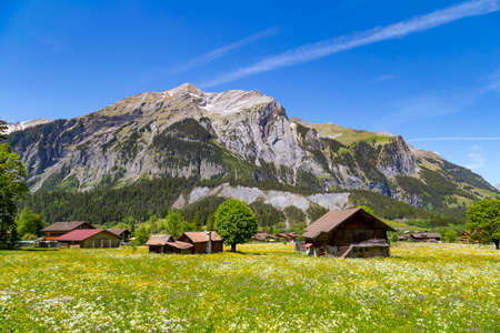 oberland: Panorama view of the Alps and Bluemlisalp on the hiking path near Kandersteg on Bernese Oberland in Switzerland Stock Photo