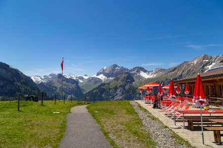 the bernese oberland: Amazing view of Cafe with red umbrellas in Swiss Alps near Oeschinensee Oeschinen lake, on Bernese Oberland, Switzerland Editorial