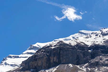 oberland: View of mountain rocks and ice-capped Swiss Alps near Oeschinensee Oeschinen lake, on Bernese Oberland, Switzerland Stock Photo