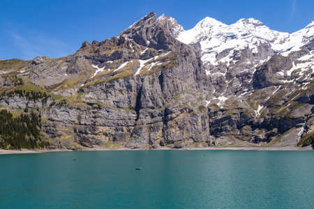 the bernese oberland: View of Oeschinensee Oeschinen lake with Bluemlisalp and Frundenhorn of Swiss alps on Bernese Oberland Stock Photo