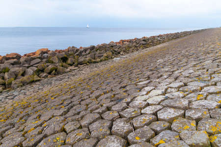 Dutch dike by the North Sea made of concrete stones, Netherlands