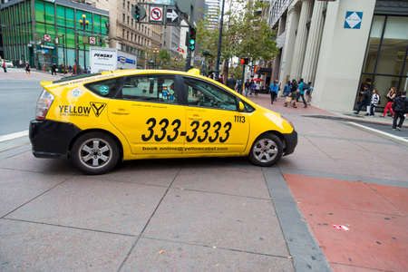taxicab: Yellow taxicab making turn on streets of San Francisco, California Editorial