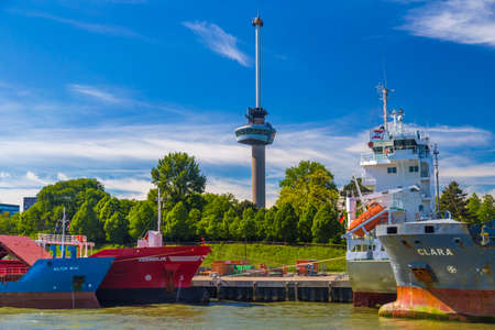 euromast: Euromast Tower seen among ships in Port of Rotterdam during a clear sunny day Editorial