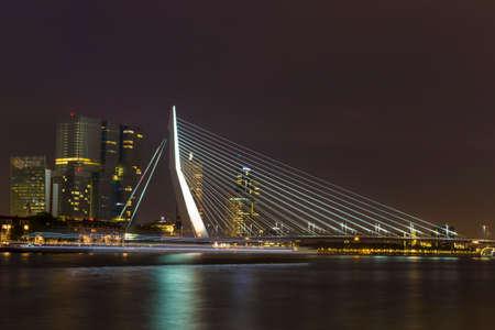 maas: Nightview of the Erasmus Bridge reflected in Nieuwe Maas river in Rotterdam, Netherlands