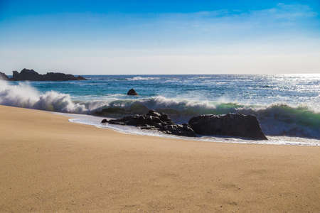 ocean state: Huge ocean waves crushing on rocks in Garrapata State Beach in California, USA