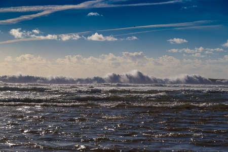 Huge ocean waves blending with skyline near Sagres, Portugal.