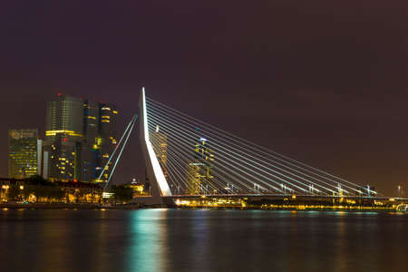 nightview: Nightview of the Erasmus Bridge reflected in Nieuwe Maas river in Rotterdam, Netherlands