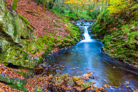 Autumnal torrents and small waterfalls in Hoegne Valley, Belgian Ardennes Stock Photo