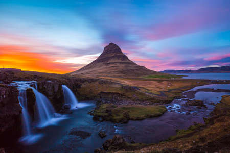 Kirkjufell Church mountain at sunset with pink and orange skyline, Iceland Stok Fotoğraf