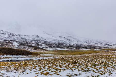 Scenic view of Oxnadalur valley near Akureyri, north coast, Iceland during snow storm Stok Fotoğraf
