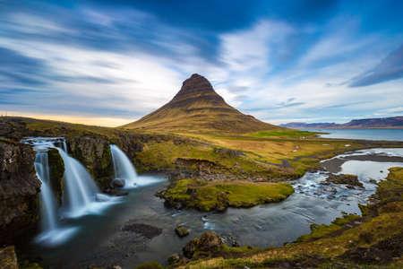 Kirkjufellsfoss waterfall with Kirkjufell mountain in the background at sunset, Iceland Stok Fotoğraf