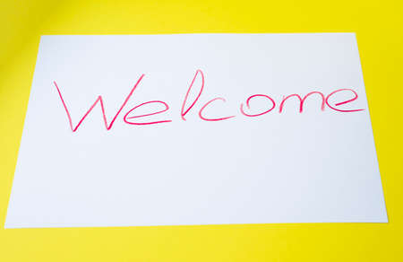 Welcome sign. Vintage sign with welcome word on ribbon. Retro style illustration on yellow background