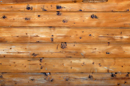 distressed wood: Wheathered distressed pine wood, colored in yellow orange  Close-up  Stock Photo