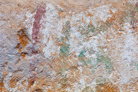 One ancient block of stone, close-up, with a colored ornamentation by brush strokes  photo