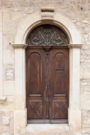 ornamente: Brown aged rounded door of a an old mansion, France