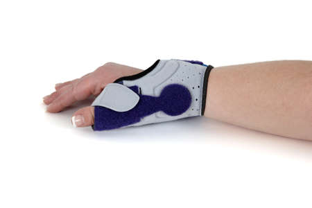 carpal tunnel: Wrist Orthosis for treating a carpal tunnel Syndrome, isolated on white   Stock Photo