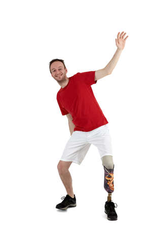 amputation: Male prosthesis wearer with a lower leg amputation demonstrating balancing while leaning his weight backwards to prove his agility