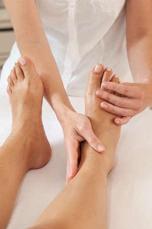 Professional feet massage - female massager and female feet