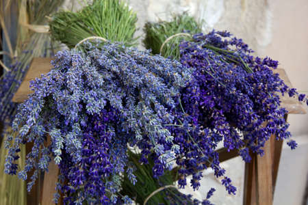 lavender bushes: Lavender bunches tied together with string, lying on wooden table for sale  Provence, France  Stock Photo