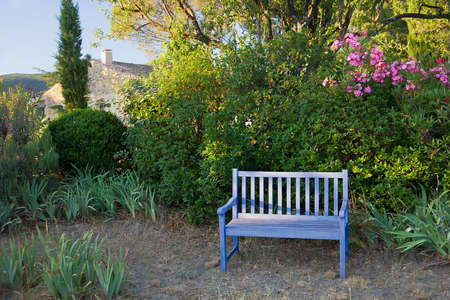 Blue Painted Wooden Garden Bench In A Leafy Rural Garden In Provence,..  Stock Photo, Picture And Royalty Free Image. Image 26919367.