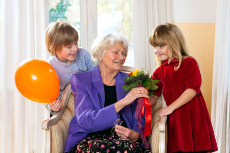 grand kids: Grandma feels happy as she receives flowers from grand kids for her birthday.