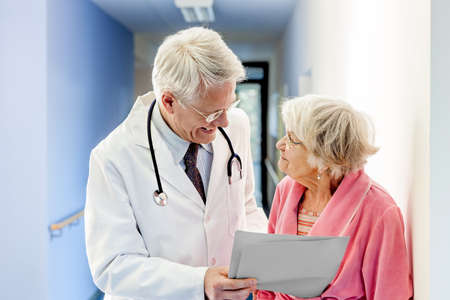 woman doctor: Doctor Talking to Old Woman about Good Results at the hospital.