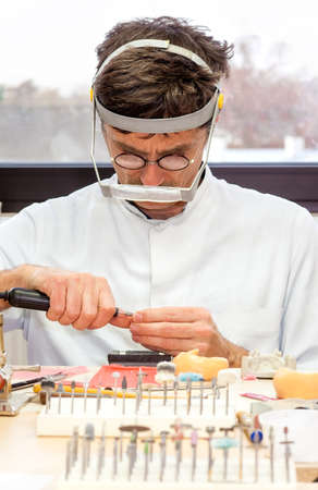 Prosthetist Busy Making Artificial Facial Dental Inside Laboratory