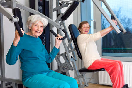 intervertebral disc: Happy Elderly Women Working Out at the Fitness Gym While Looking at the Camera.