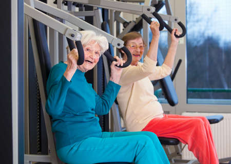 intervertebral disc: Happy Healthy Old Women Exercising at the Fitness Gym, Looking at the Camera.