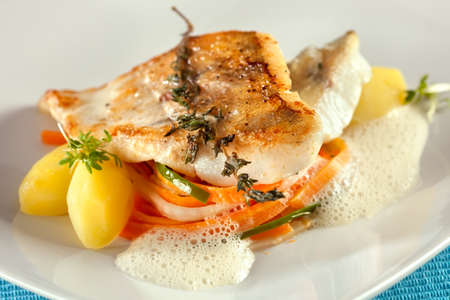 zander: Fried pike perch with carrots, cucumbers, potates. Stock Photo