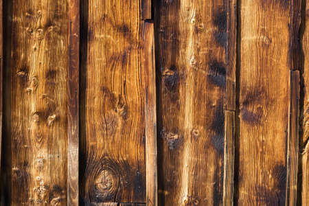 knotty: Exterior wooden rustic wall covered with paneling made of vertical lumber boards traditional architectural detail from Thyon Swiss Alps Valais closeup Stock Photo