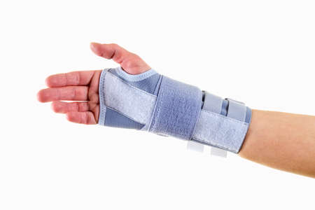 carpal tunnel syndrome: Close Up of Man Wearing Supportive Orthopedic Wrist Brace in Studio with White Background and Copy Space Stock Photo