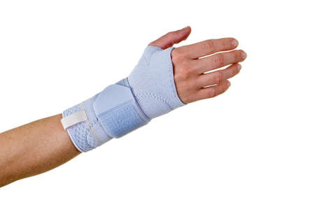 Close Up of Person with Hand and Wrist Wrapped in Supportive Brace and Secured with Velcro Strap in Studio with White Background