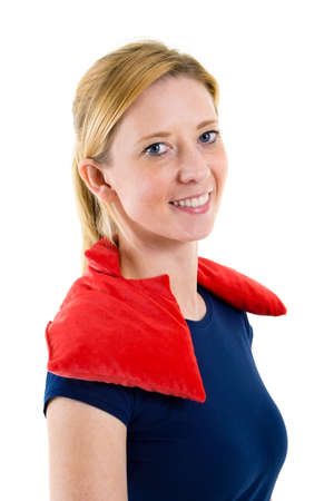 tenseness: Close Up Portrait of Smiling Blond Woman Relaxing with Red Heat or Cold Pack on Shoulders in Studio with White Background