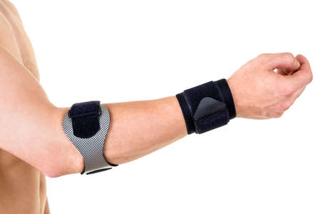 orthopedic: Close Up of Man Wearing Orthopedic Wrist and Elbow Braces in Studio with White Background and Copy Space