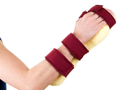 cushioned: Close Up of Person Wearing Cushioned Brace on Hand and Wrist Secured with Red Velcro Straps in Studio with White Background and Copy Space Stock Photo