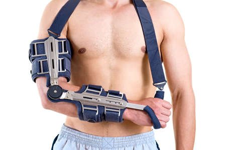 elbow bandage support: Close Up of Shirtless Athletic Man with Arm Secured in Modern Sling with Articulated Elbow in Studio with White Background