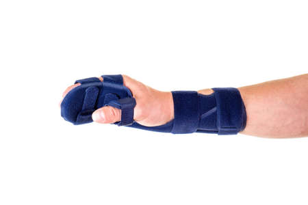 post operative: Close Up of Man with Hand Wrapped in Blue Wrist and Hand Supportive Brace and Secured with Velcro Straps in Studio with White Background