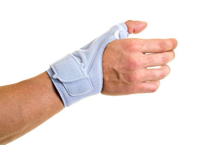 Close Up of Man Wearing Modern Supportive Orthopedic Brace on Wrist, Hand and Thumb, Secured by Velcro Strap, in Studio with White Background and Copy Space