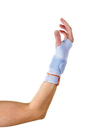 elbow brace: Close Up of Man with Bent Elbow Wearing Modern Supportive Orthopedic Wrist Brace Secured with Velcro Strap in Studio with White Background Stock Photo