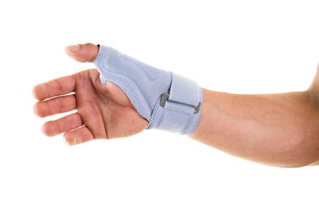 velcro: Close Up of Man Wearing Modern Supportive Orthopedic Brace on Wrist, Hand and Thumb, Secured by Velcro Strap, in Studio with White Background and Copy Space