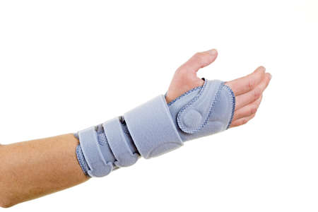 Close Up of Man Wearing Supportive Orthopedic Wrist Brace in Studio with White Background and Copy Space