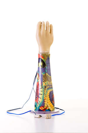 forearm: Still Life of Electronic Prosthetic Arm with Psychedelic Patterns on Forearm, in Studio with White Background and Copy Space Stock Photo