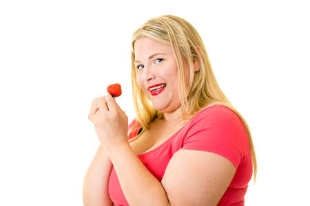glandular: Smiling blond woman with ripe strawberry looking over shoulder on white