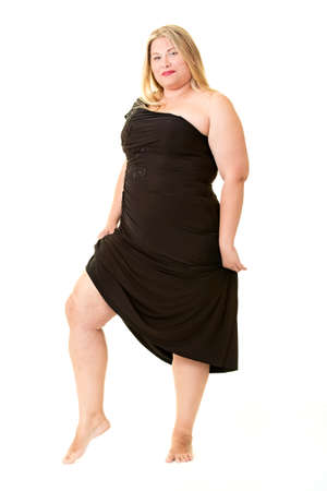 Attractive overweight woman in black evening dress, full length on white Stock Photo