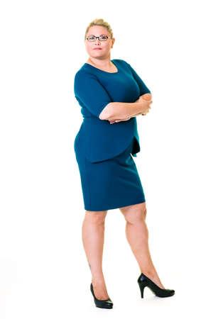 authoritative woman: Full length portrait of confident female executive in blue dress on white background. Stock Photo