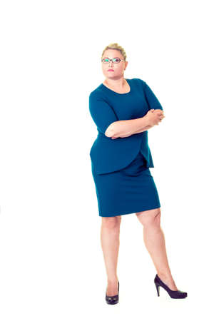 Full length portrait of confident business woman with folded arms in blue dress on white background.