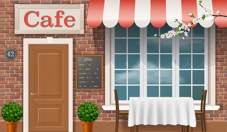 french doors: Facade of a traditional cafe with a window door awnings.